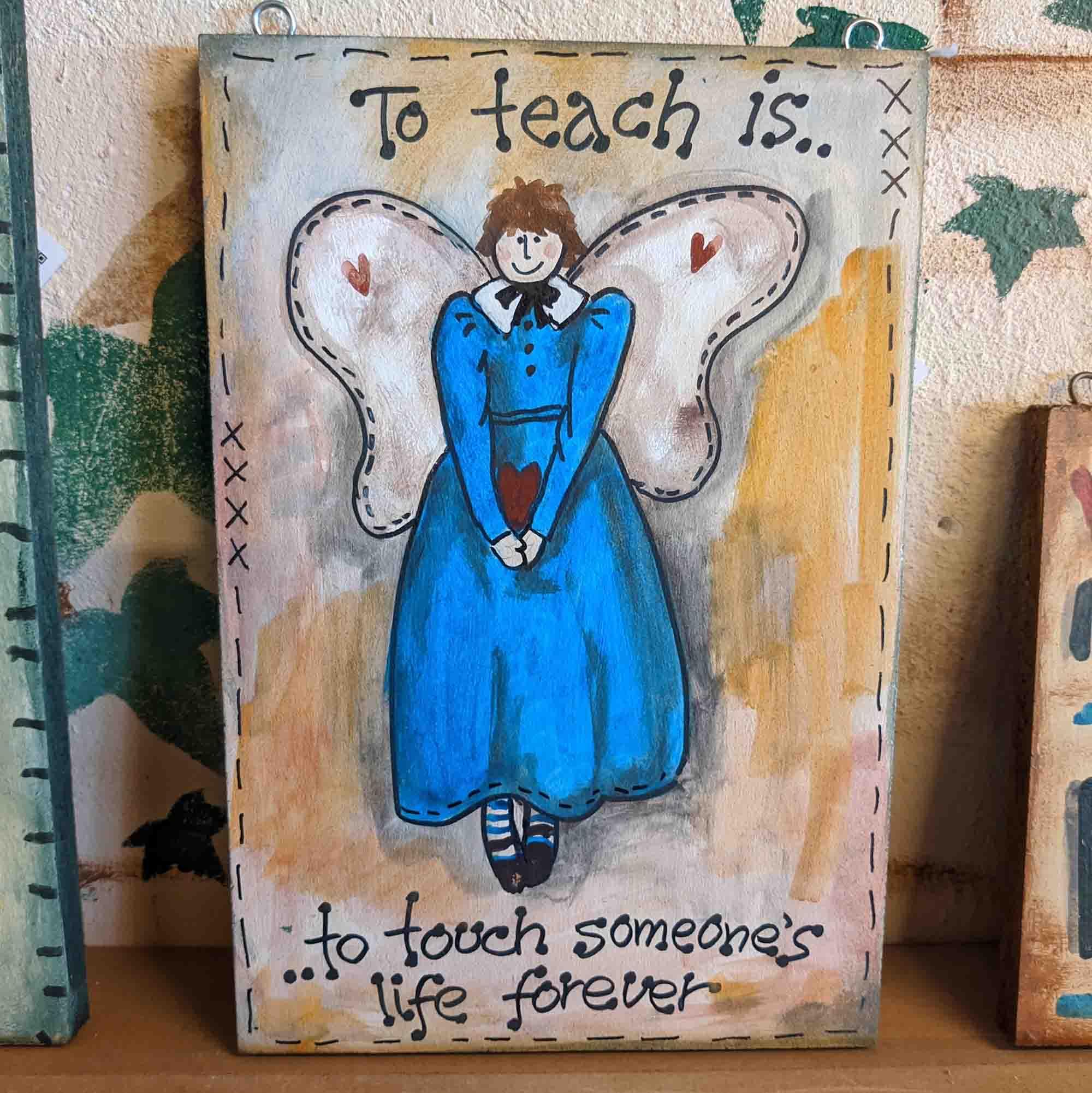 Ξύλινος πίνακας – Wooden sign, To teach is..