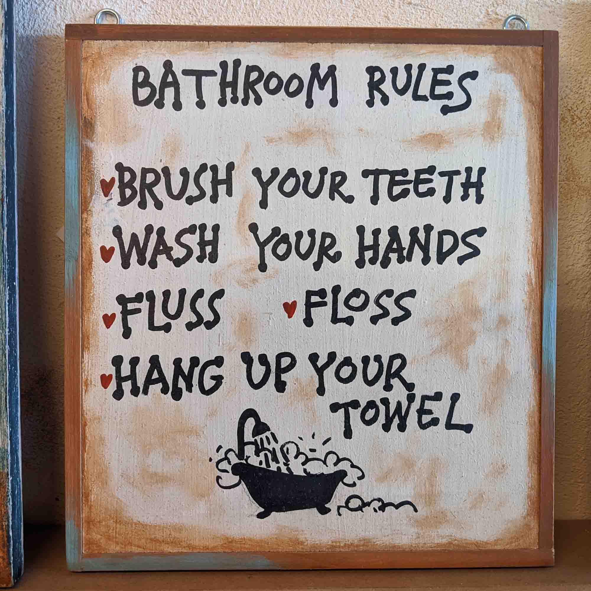 Ξύλινη πινακίδα, BATHROOM RULES …